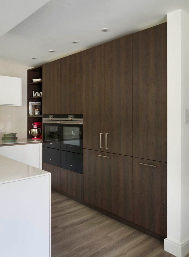Modern, contemporary style tall kitchen units in wood finish with buit in Gaggenau appliances