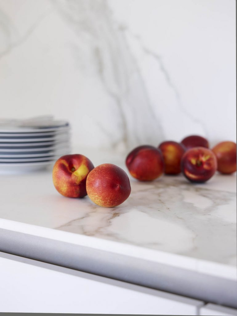 Peaches resting on marble effect porcelain worktop