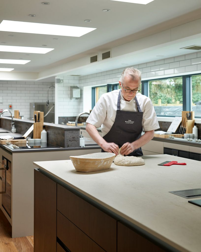 "Michelin Star Chef John Campbell kneading dough in his renovated cookery school ""The Woodspeen"""