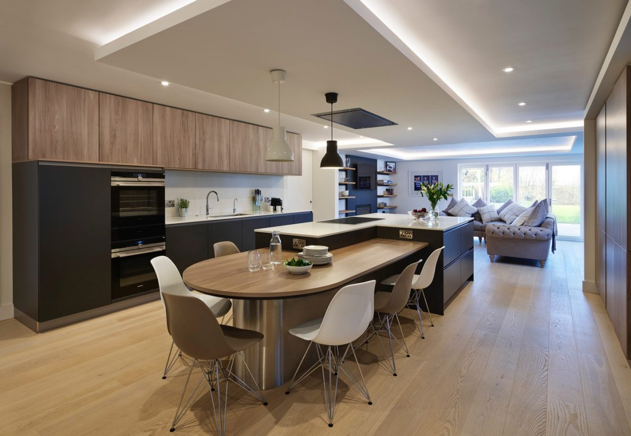 Contemporary open plan pro norm kitchen with Gaggenau appliances in timber, black and white porcelain work surface finishes
