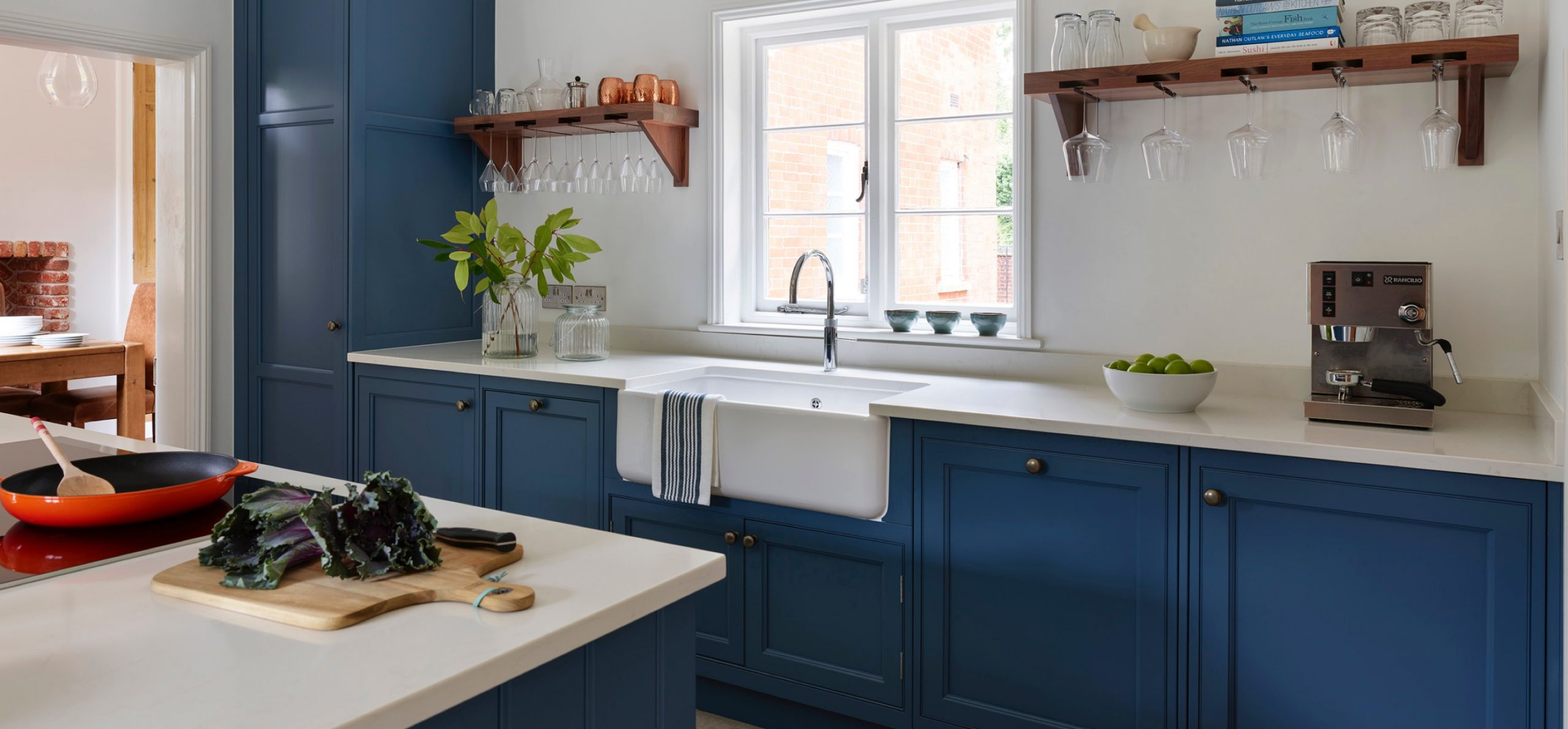 Blue and white traditional hand-made kitchen with composite worktop and island unit