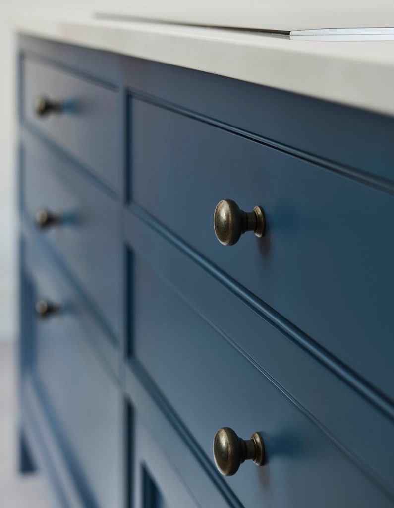 Hand-made blue drawer unit with brass opening knobs