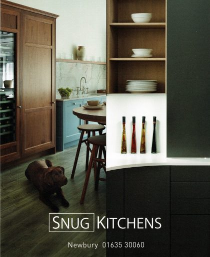 Snug kitchens showroom with Skipper the dog